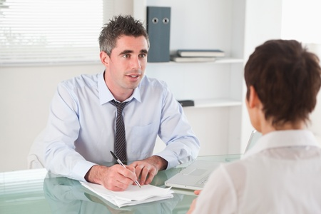 Manager interviewing a candidate in his office photo