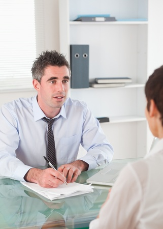 Portrait of a manager interviewing an applicant in his office photo