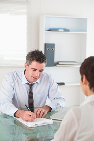 Portrait of a manager interviewing a female applicant in his office photo
