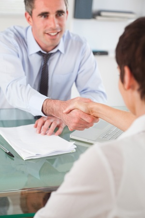 lawyer meeting: Portrait of a manager and an applicant having a handshake in an office