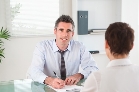 councilor: Manager interviewing a female applicant in his office Stock Photo
