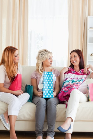 Young Women with shopping bags in a living room photo
