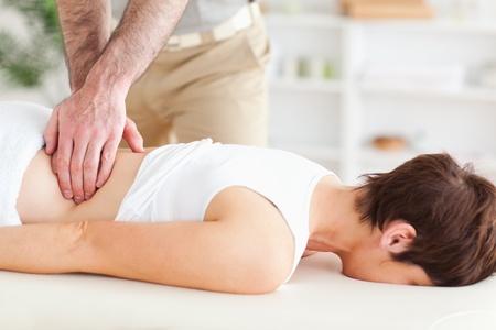 Man massaging a cute woman in a room photo