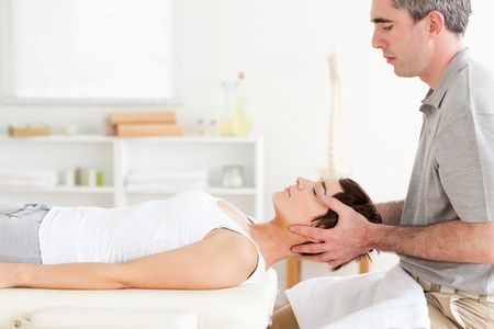 strength therapy: Man stretching a cute woman in a room