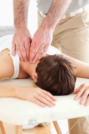 Woman getting a neck-massage in a room photo
