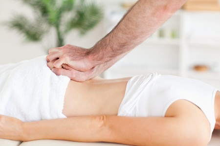 acupressure hands: Cute Woman getting a back-massage in a room