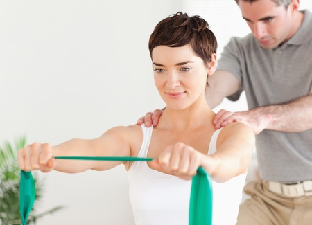 physiotherapist: Patient doing some special exercises under supervision in a room Stock Photo