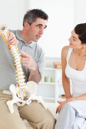 Chiropractor explaining the spine to his patient in a room Stock Photo - 11191326