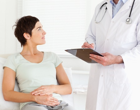 Woman lying down in a doctors office photo