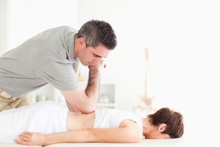 Woman relaxing during a back-massage in a room photo