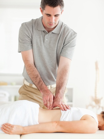 back massage: Gorgeous woman getting a back-massage in a room