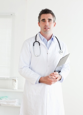 Doctor looking into the camera in a room photo