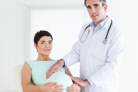 Portrait of a doctor and a pregnant woman in a room Stock Photo - 11213878