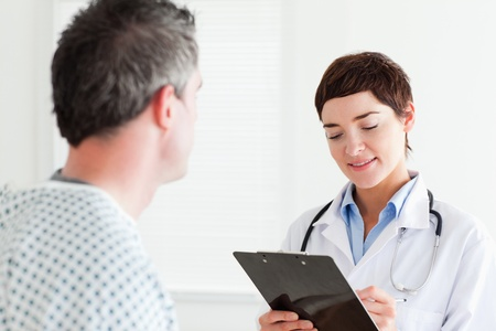 Doctor talking to a male patient in a room photo