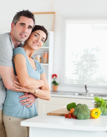 Charming Man and woman hugging in a kitchen photo