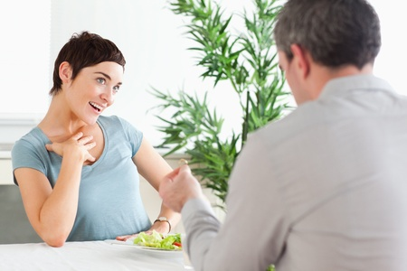 Handsome Man proposing to smiling girlfriend in a restaurant Stock Photo - 11188981