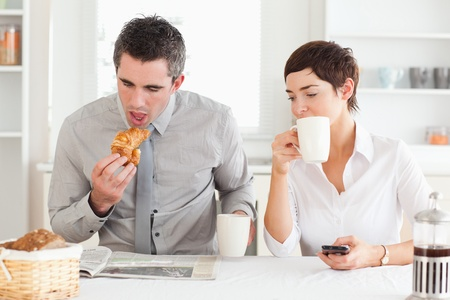A cheerful couple is having breakfast together Stock Photo - 11190455