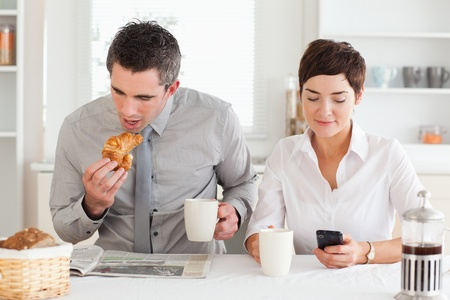 A couple is having breakfast before work photo