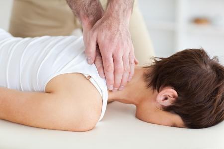 masseur: A masseur is massaging a customers neck