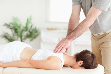 A masseur is massaging a female customer's back Stock Photo - 11190879
