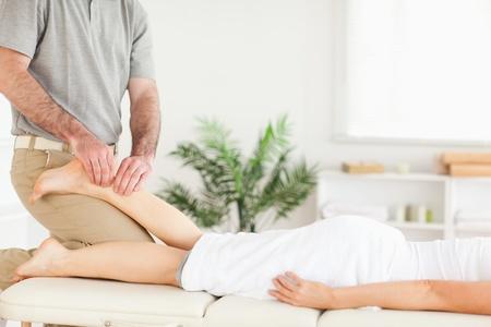 masseur: A masseur massages a customers foot Stock Photo