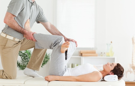 A chiropractor is working with a woman Stock Photo