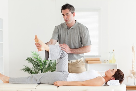 A chiropractor is working with a customer photo