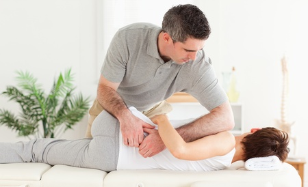 strength therapy: A masseur is massaging a customer Stock Photo