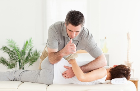 Masseur massaging a female customer photo