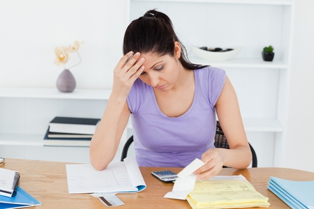 A frustrated young woman is accounting photo