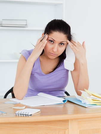 A tired young female is doing banking Stock Photo - 11214465
