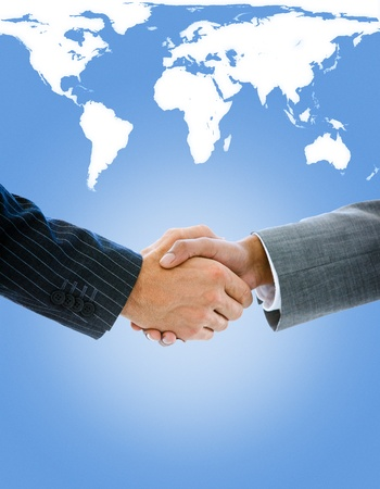 Close-up of a business people shaking hands against a white background photo