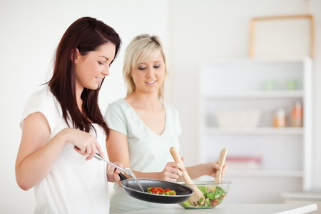 Gorgeous Women cooking dinner in a kitchen photo