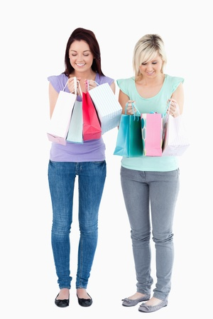 Cute women with shopping bags in a studio photo