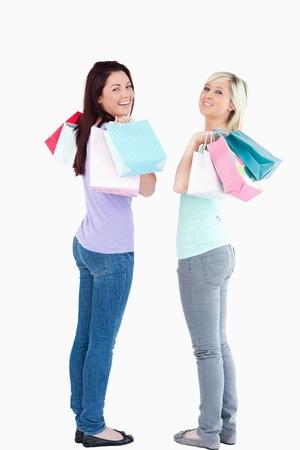 Beautiful women with shopping bags in a studio photo