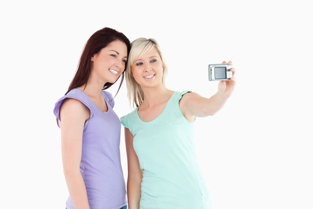 Cheerful women with a camera in a studio photo
