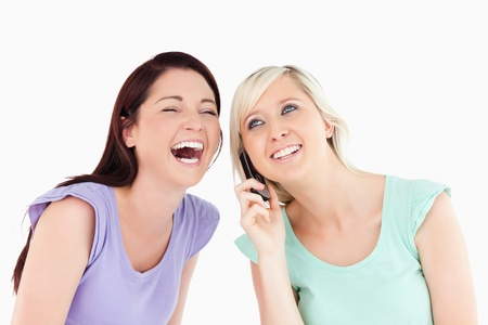 Cheering women on the phone in a studio photo