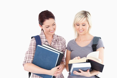 Two cute female students reading a book Stock Photo - 11214551