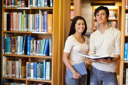 Students holding books in the library photo