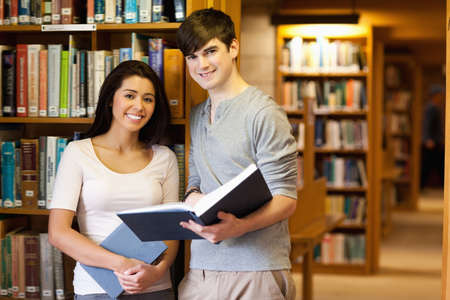 Young students with a book in the library photo