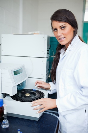 centrifuge: Serious scientist using a centrifuge in a laboratory Stock Photo
