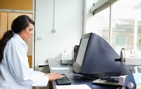 Female scientist using a monitor in a laboratory Stock Photo - 11214627