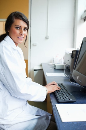 Portrait of a female scientist with a monitor looking at the camera Stock Photo - 11188975