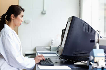 Science student using a monitor in a laboratory Stock Photo - 11189827