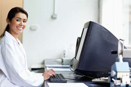 Science student with a monitor looking at the camera Stock Photo - 11188980