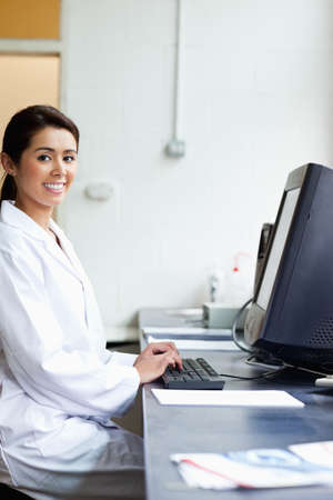 Portrait of a science student with a monitor looking at the camera Stock Photo - 11189661
