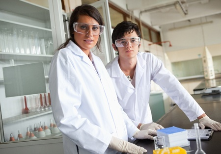 Science students wearing protective glasses in a laboratory Stock Photo - 11187294