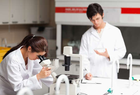 Young science students making experiments in a laboratory Stock Photo - 11207352