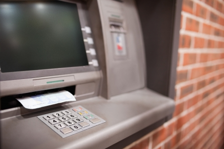 Close up of an ATM with a twenty euros notes in it photo