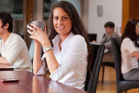 Young woman having a coffee in a cafe photo